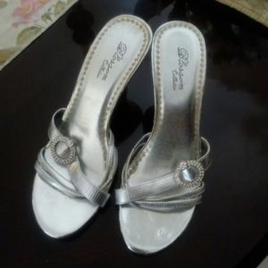 Silver shoes. Good for casual or evening wear.